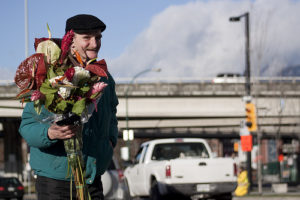 Homeless person, using flowers to make food happen